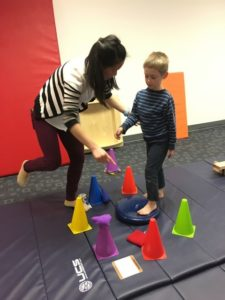 kid training with cones at Physical Therapy in Southington